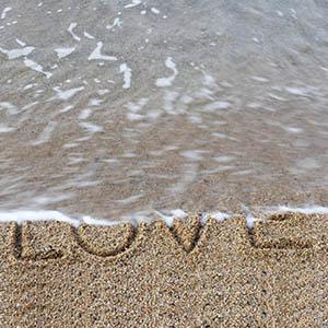 The word love erased by ocean Mediation